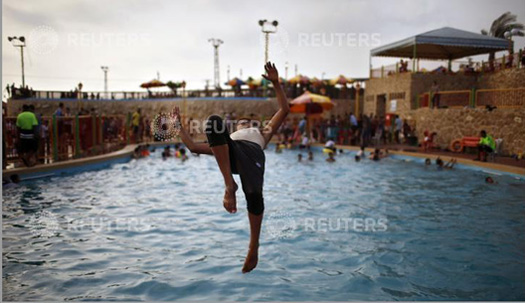 a palestinian jumps inside a swimming pool at al nour resort in gaza city june 12 2013 al nour resort was established on the land of former jewish - Olympic Swimming Pool 2013
