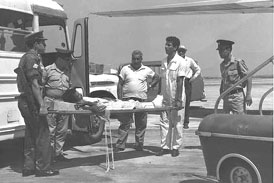 Wounded POW transported