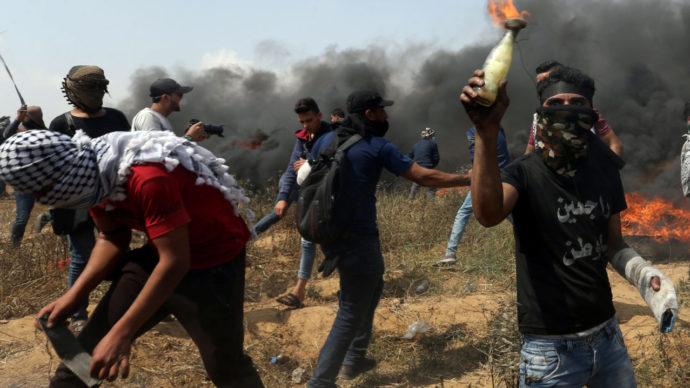 Masked Palestinian holding Molotov cocktail.