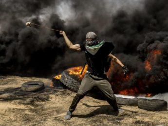 Gaza rioter hurling stones