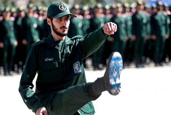 An Iranian Revolutionary Guard cadet with Israeli flag on sole of shoe