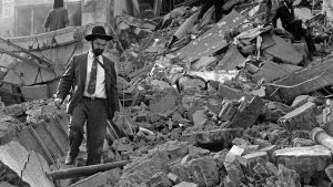 A Jewish man walks in the rubble of the AMIA Jewish center bombed by Iran